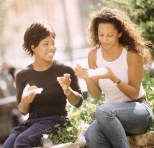 Friends Eating Lunch Outdoors --- Image by © Steve Prezant/CORBIS